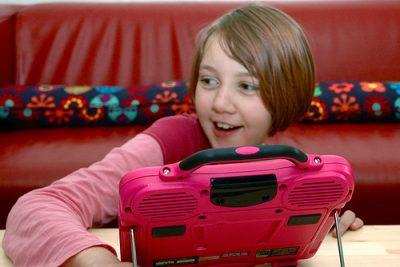 Girl using her listening device