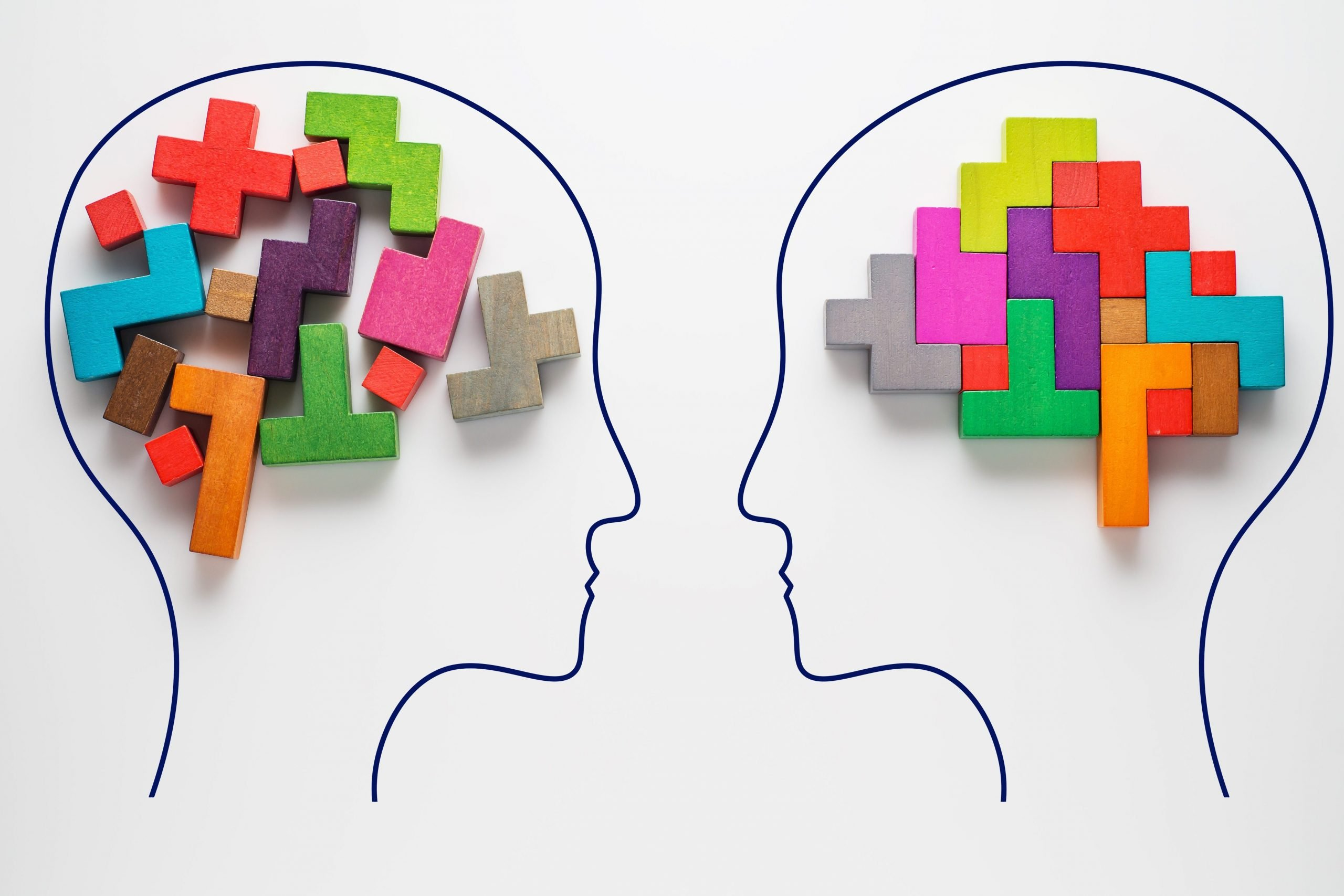 Heads of two people with colourful shapes of abstract brain for concept of idea