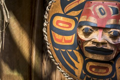Close up of a painted Native American totem face.