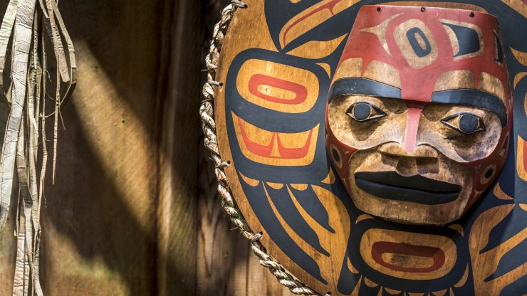 Close up of a painted Native American face.