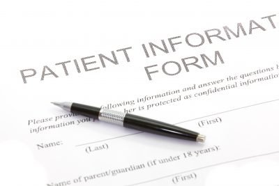 A Patient Form is displayed with a ball point pen on top
